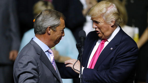 """Republican presidential nominee Donald Trump greets British politician Nigel Farage during a campaign rally in Jackson, Miss., on Aug. 24, 2016. Journalist Carole Cadwalladr says """"there are so many overlaps"""" between Russia, the Trump campaign and the Brexit vote."""