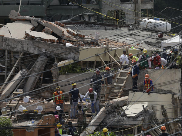 Search and rescue efforts at the Enrique Rébsamen school that collapsed after an earthquake in Mexico City in September 2017.