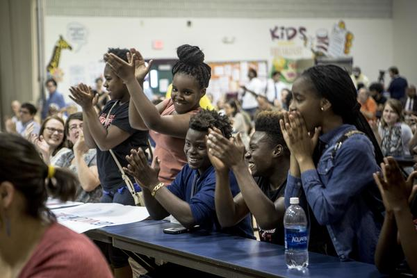 High school students applaud a classmate who spoke during a June 2017 organizing meeting for #TakeEmDown901, which formed in Memphis to protest the city's Confederate statues.
