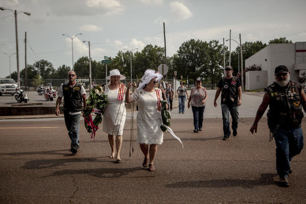 Members of the United Daughters of the Confederacy and the Sons of Confederate Veterans arrive to lay wreaths at Health Sciences Park, where the statue of Nathan Bedford Forrest stood in Memphis.