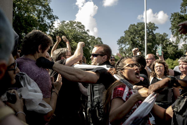 Protesters and the police struggle in August 2017 after officers tore down banners that demonstrators attempted to hang on a statue of Nathan Bedford Forrest in Memphis.