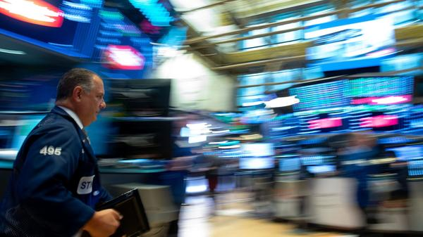 Traders work on the floor at the closing bell of the Dow Industrial Average at the New York Stock Exchange on July 26, 2018 in New York.