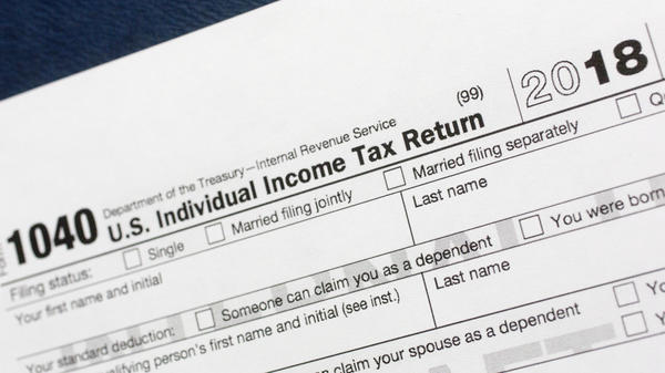 The fatter paychecks that many Americans have been receiving this year may end with a big check to the government come tax time.