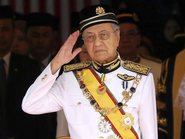 Malaysia's Prime Minister Mahathir Mohamad salutes during the opening of a session of parliament in Kuala Lumpur on July 17.