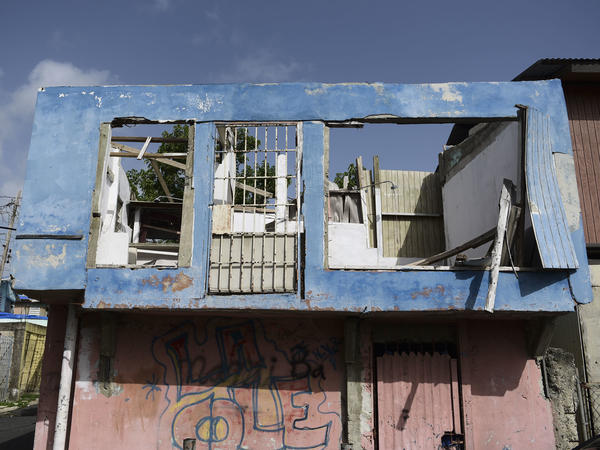 In this June 13 photo, a residence in the Figueroa neighborhood stands destroyed nine months after Hurricane Maria, in San Juan, Puerto Rico. On Wednesday a federal judge extended a temporary housing program for territory residents whose homes were destroyed.