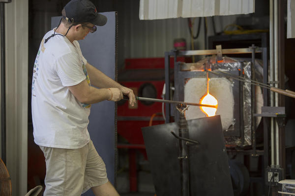 Jeremiah Jacobs said he's had as many as 80 people in one session crowd around to watch him and his colleagues transform layers of molten glass into colorful works of art.