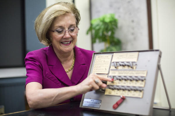 Travis County Clerk Dana DeBeauvoir demonstrates how to vote using an analog voting machine in the Travis County Courthouse in downtown Austin. Voting officials around the country are getting federal money to make their voting systems more secure.