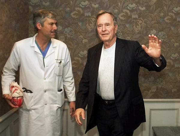 Hausknecht accompanies Bush as the former president leaves Houston's Methodist Hospital in February 2000.