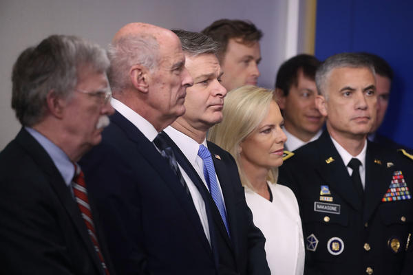 National security adviser John Bolton (from left), Director of National Intelligence Dan Coats, FBI Director Christopher Wray, Homeland Security Secretary Kirstjen Nielsen and chief of U.S. Cyber Command Gen. Paul M. Nakasone attend a press briefing on election security at the White House on Thursday.