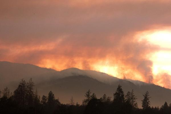 <p>The smoke of the Taylor Creek Fire still plumes behind the Joint Information Center, just outside of Grants Pass, OR.</p>