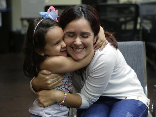Natalia Oliveira da Silva and her daughter, Sara, 5, hug at a Catholic Charities facility in San Antonio, TX. They were separated in late May.
