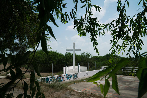 A cross erected just feet from the Rio Grande border and several of the bridges between Matamoros, Mexico, and Brownsville, Texas, is a popular stop where migrants pray before the final steps of their journey to the U.S.