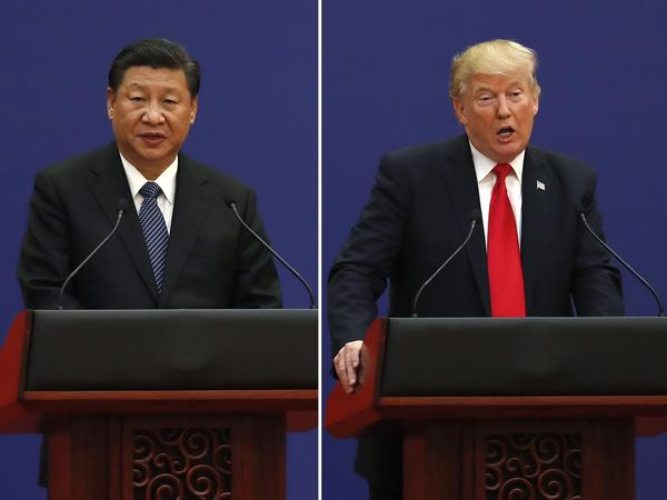 U.S. President Donald Trump, right, and Chinese President Xi Jinping speak during a business event at the Great Hall of the People in Beijing November 2017.