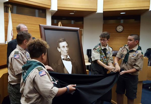 Members of Boy Scout Troop 332 from Macomb helped unveil the portrait