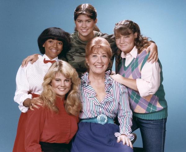 """Girls! Girls! <em>Giii</em>-iirls!"" (Clockwise from top): Nancy McKeon as Jo, Mindy Cohn as Natalie, Charlotte Rae as Mrs. Garrett, Lisa Whelchel as Blair, Kim Fields Tootie."