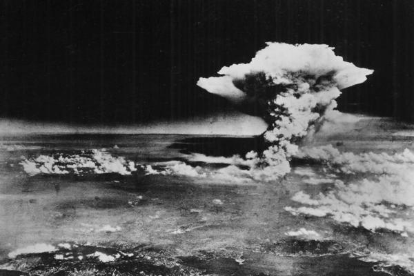 """A huge cloud resulting from the massive fires started by """"Little Boy,"""" the atomic bomb dropped on Hiroshima, is photographed from a reconnaissance plane a few hours after the initial explosion."""