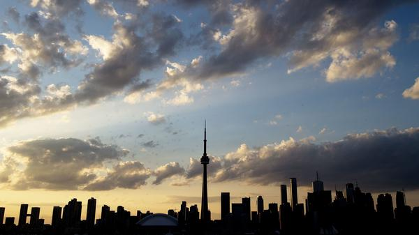 The Toronto skyline, seen in silhouette in 2015. The same skyline was used in an image posted by an account reportedly linked with the Saudi Arabian government, which featured an airliner headed toward the needle-shaped CN Tower.