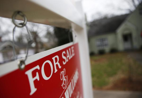 "This Jan. 26, 2016 file photo shows a ""For Sale"" sign hanging in front of an existing home in Atlanta.  Short of savings and burdened by debt, America's millennials are struggling to afford their first homes in the face of sharply higher prices in many of the most desirable cities. Surveys show that most Americans under 35 lack adequate savings for down payments. The result is that many will likely be forced to delay home ownership and to absorb significant debt loads if they do eventually buy. (John Bazemore, File/AP)"