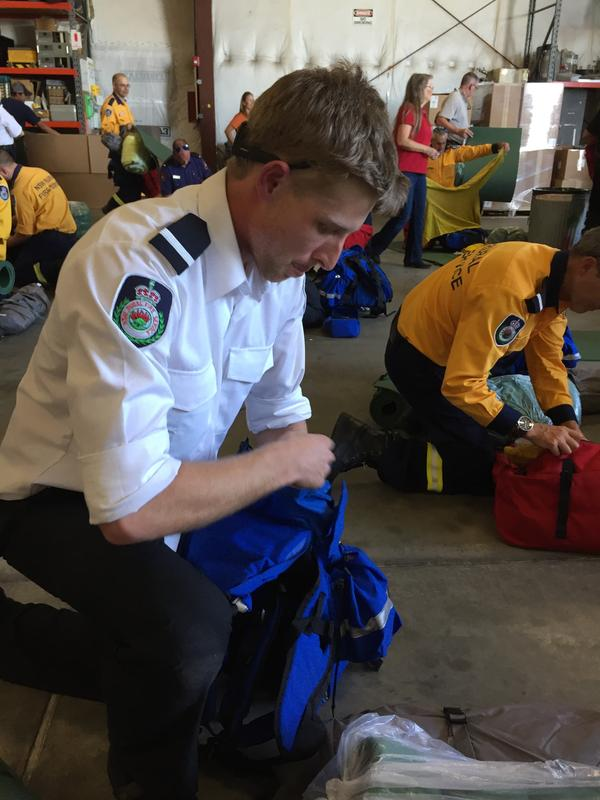 "Dan McAndrew is in the U.S. from Australia's New South Wales Rural Fire Service. Among the items he's stuffing his pack with are camping gear, a sleeping bag and a uniform. ""We'll be wearing the local uniforms here so we fit in,"" he says. This isn't his first time abroad to fight wildfires. He was deployed to Canada last year."