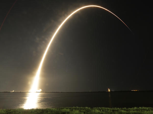 A Falcon 9 SpaceX rocket lifts off from the Cape Canaveral Air Force Station Complex 40 launch pad as seen through a time exposure in Cape Canaveral, Fla., early Tuesday.