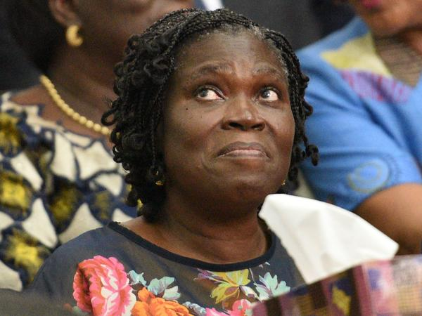 Simone Gbagbo, Ivory Coast's former first lady, awaits the start of her trial in Abidjan in 2014. She would ultimately be sentenced to 20 years in prison for her role in the violence that followed the 2010 election — but now the man who won that election, President Alassane Ouattara, has announced plans to pardon her and hundreds of others.