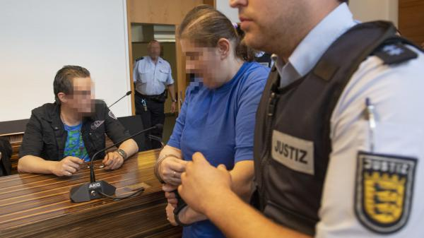 The defendant identified as Berrin T. (right) is led past defendant Christian L. (left) ahead of their sentencing hearing Tuesday at the district court in Freiburg, Germany. Their faces have been pixelated in accordance with court orders.