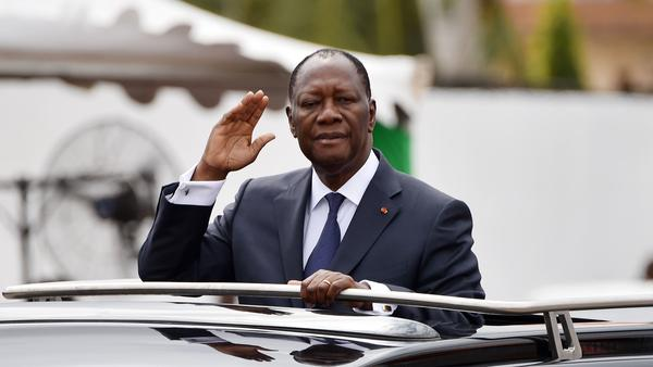 Ivory Coast President Alassane Ouattara salutes from his car during an independence celebration Tuesday in Abidjan.
