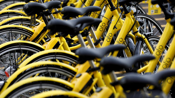 In the past year, thousands of Ofo bicycles have popped up on the sidewalks of Dallas and other cities — but the company has recently been shrinking its operations. These bikes were photographed in Singapore last summer.