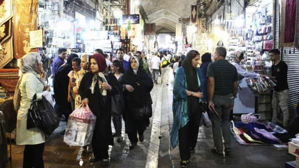 People walk at the old main bazaar in Tehran, Iran, last month. The strained Iranian economy is bracing for the impact of new U.S. sanctions that went into effect Tuesday.