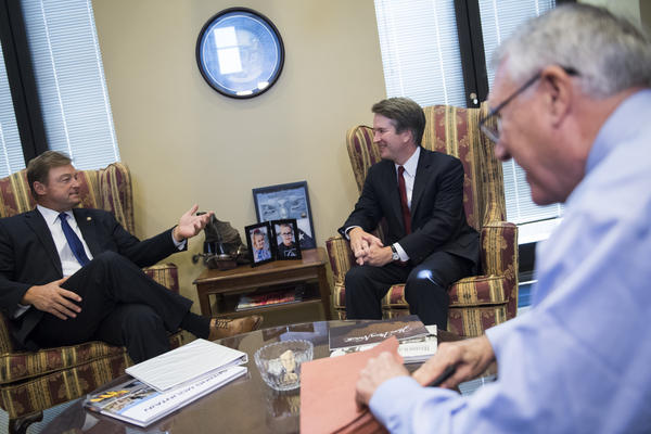 "Supreme Court nominee Brett Kavanaugh, center, Sen. Dean Heller, R-Nev., left, and former Sen. Jon Kyl, R-Ariz., meet in July 2018. Kyl is serving as Kavanaugh's ""Sherpa"" as he introduces him to members of Congress."