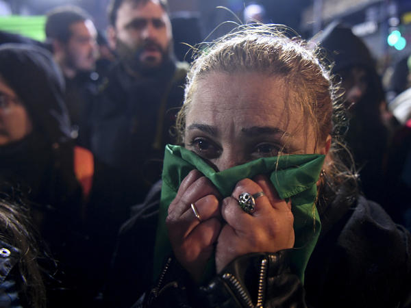 An abortion-rights activist reacts outside the National Congress in Buenos Aires, on Thursday to news that the Senate voted to reject a bill that would have legalized abortion.