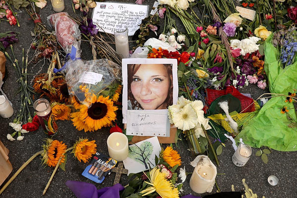 Flowers, candles and messages surround a photograph of Heyer a few days after her death in 2017.