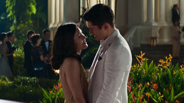 Rachel (Constance Wu) and Nick (Henry Golding) share a moment in the Singapore moonlight in <em>Crazy Rich Asians</em>.