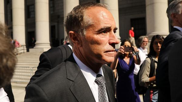 "Rep. Chris Collins, R-N.Y., walks out of a New York court house after being charged with insider trading on Wednesday. Democrats are seizing on the case to convince voters the GOP has a ""culture of corruption."""