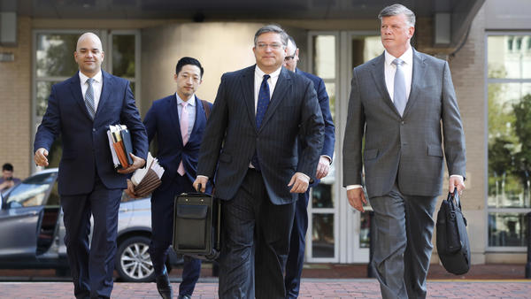 The defense team for Paul Manafort, including Kevin Downing, right, and Jay Nanavati, far left, walks into federal court on Thursday. After prosecutors rest, as they're expected to do Friday, the defense will have a chance to call witnesses and make their case.