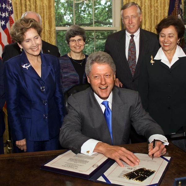 Then-Rep. Connie Morella, R-Md., looks on in the Oval Office as President Clinton signs a $28 billion bill financing the Treasury Department and providing pay increases for Congress and executive branch workers on Sept. 29, 1999.