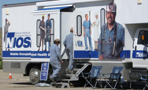Miners walk into the mobile health clinic as it makes a stop in Morgantown, WV.
