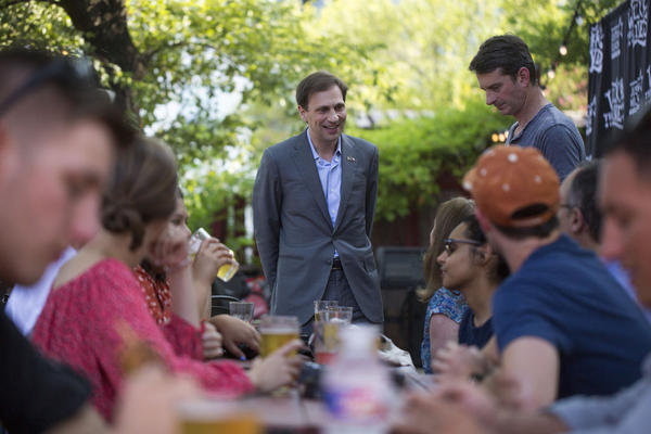 Texas Attorney General Candidate Justin Nelson speaks at the Shangri-La bar in Congressional District 35 as part of a pub crawl across three congressional districts in downtown Austin - the Pub Crawl to End Gerrymandering.