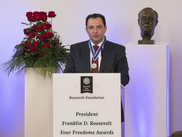 Syrian lawyer Mazen Darwish gives a speech after he was awarded the Freedom of Speech and Expression Award on April 21, 2016, in Middelburg, Netherlands. He is working alongside others to file criminal charges against Syrian officials.