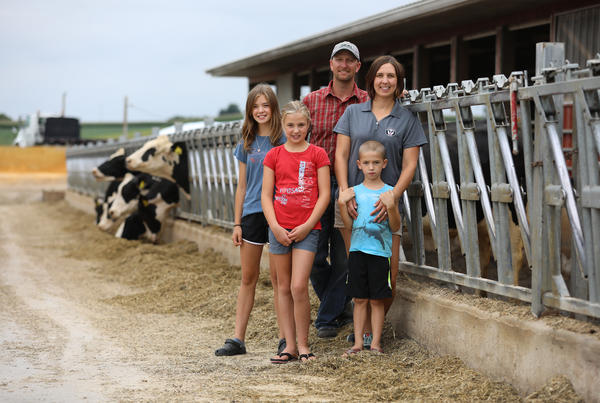 Travis Clark and Janet Clark are pictured with their three children, from left, Grace, 13, Eve, 10, and Levi, 6, at Vision Aire Farms.