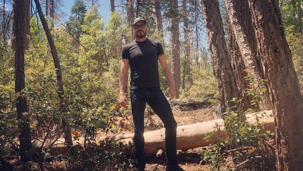 UC Merced Professor Leroy Westerling in Yosemite Valley in a patch of dead pine trees killed by bark beetles during the drought.