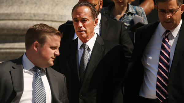 Rep. Chris Collins, R-NY, walks out of a New York court house. He faces charges related to insider trading.