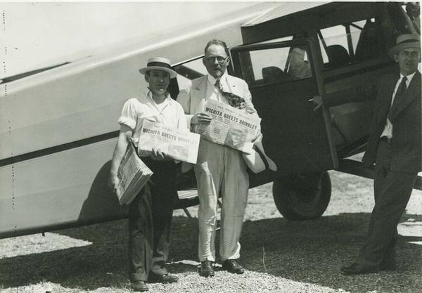 John R. Brinkley (center) in 1930 before he flew around the state as a write-in candidate for Kansas governor in 1930. It was one of the closest elections in Kansas history.