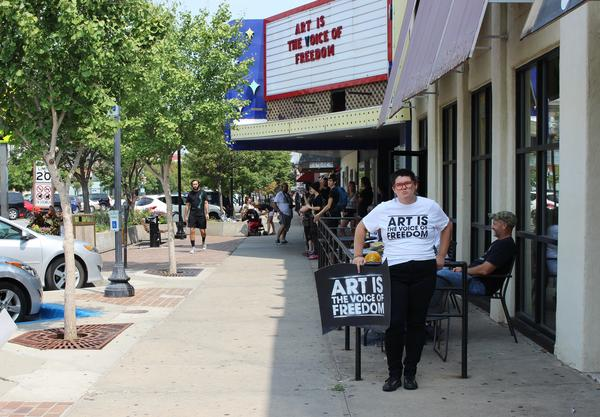 Hundreds gathered along Massachusetts Street in Lawrence, Kansas, Saturday in anticipation of a so-called 'Defend the Flag' demonstration. Both gatherings were partly in response to a recent art installation at the University of Kansas.