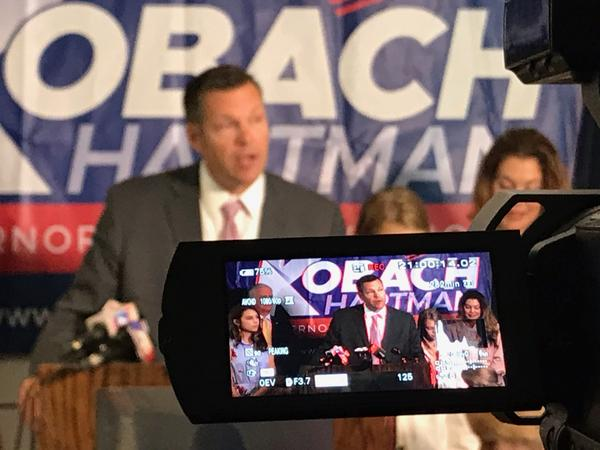 Kansas Secretary of State Kris Kobach talking with reporters earlier this week. Gov. Jeff Colyer, his Republican primary opponent, has called on Kobach to step aside from Tuesday's vote count.