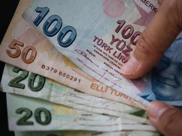 A woman sorts some Turkish Lira in Istanbul on Monday.The lira hit another record low overnight, stoking fears from foreign investors over the country's financial crisis.