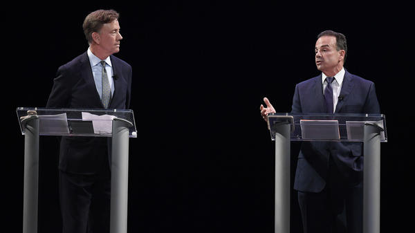 Democratic candidates for governor Ned Lamont and Bridgeport Mayor Joe Ganim debate in New Haven, Conn., last month.