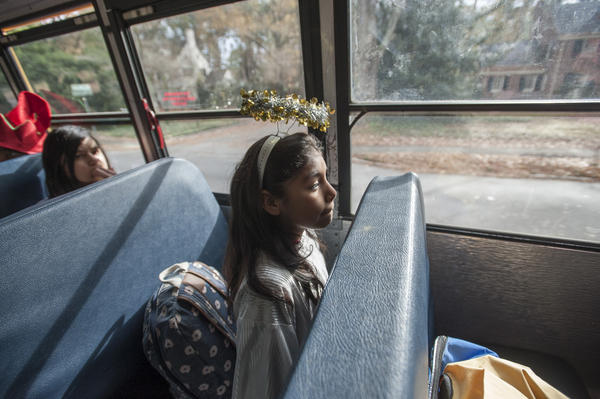 Playing the part of an angel, Esmeralda Villanueva is on her way to a Christmas presentation performed by students of the Sallie B. Howard School for the Arts and Education at a nursing home in Wilson.