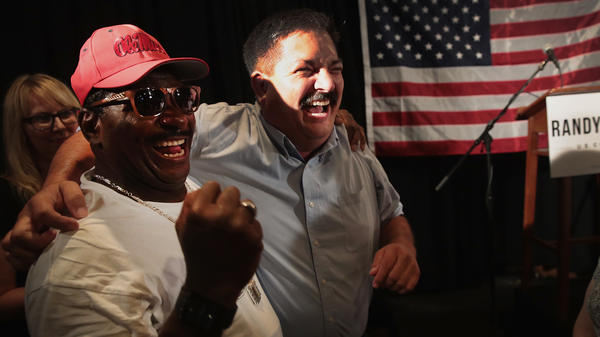 Democratic congressional candidate Randy Bryce celebrates his primary win with a supporter in Racine, Wis., on Tuesday night. Bryce will face Republican Bryan Steil for the seat being vacated by retiring House Speaker Paul Ryan.