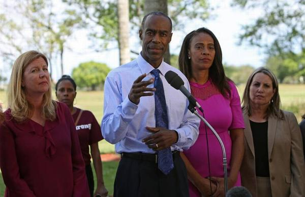 Broward County schools superintendent Robert Runcie and members of the school board hold a news conference at Marjory Stoneman Douglas High School in February. District leaders have waffled over whether to install metal detectors at schools.